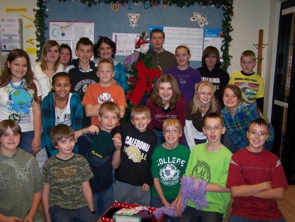 Students surrounding the Mitten/Hat Tree